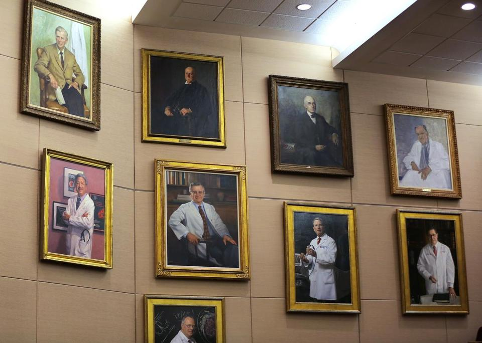 Brigham and Women's Hospital removed 31 portraits (above) of former department chairs from the walls of the hospital's amphitheater.