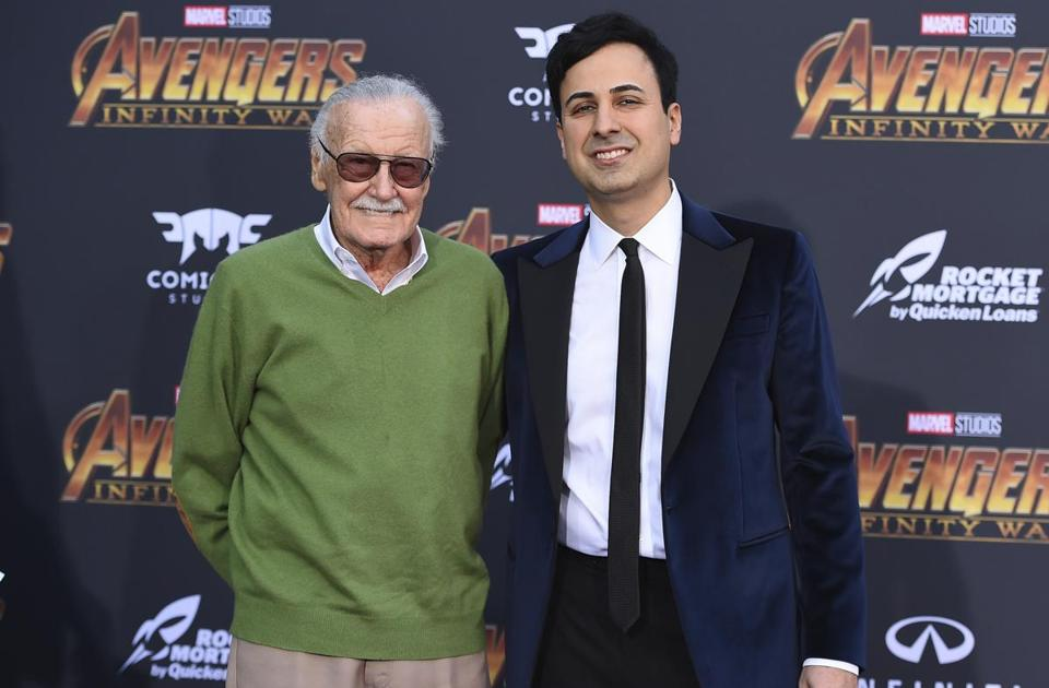 "FILE - In this April 23, 2018 file photo, Stan Lee, left, and Keya Morgan arrive at the world premiere of ""Avengers: Infinity War"" in Los Angeles. Lee has taken out a restraining order against Morgan who had been acting as his business manager and close adviser. Lee took out the order Wednesday, two days after Morgan was arrested on suspicion of filing a false police report. (Photo by Jordan Strauss/Invision/AP, File)"