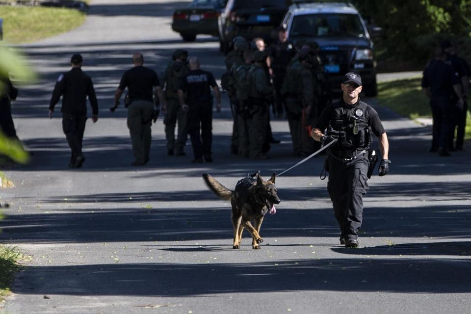 Police officers investigated the scene where a man had barricaded himself in a house in Methuen on Wednesday.