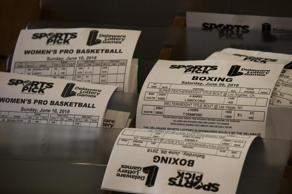 Betting slips for WNBA games and boxing matches.