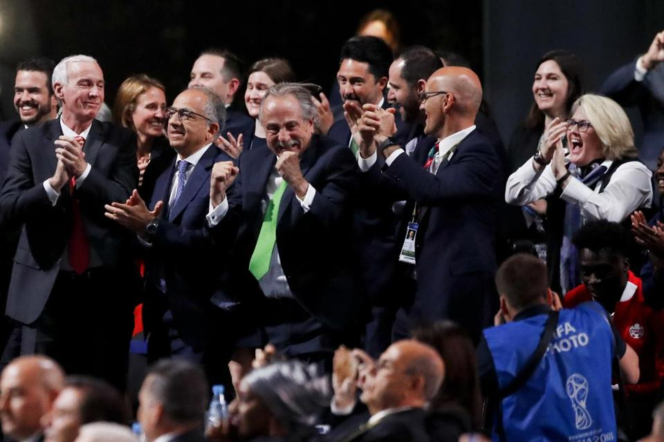 Delegates of Canada, Mexico and the United States celebrated after winning a joint bid to host the 2026 World Cup at the FIFA congress in Moscow, Russia on Wednesday.