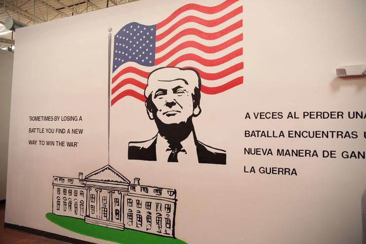 "A mural of President Trump, the first in a series of presidential murals a visitor encounters in Casa Padre, features a quote from a tweet he posted in 2014: ""Sometimes by losing a battle you find a new way to win the war."""