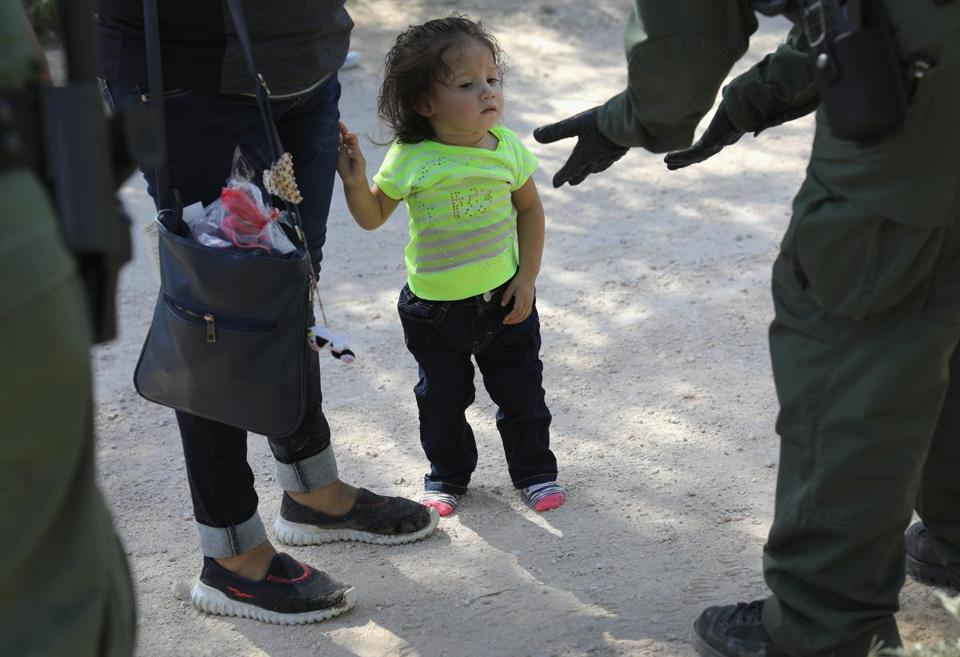 MCALLEN, TX - JUNE 12: U.S. Border Patrol agents take Central American asylum seekers into custody on June 12, 2018 near McAllen, Texas. The immigrant families were then sent to a U.S. Customs and Border Protection (CBP) processing center for possible separation. U.S. border authorities are executing the Trump administration's zero tolerance policy towards undocumented immigrants. U.S. Attorney General Jeff Sessions also said that domestic and gang violence in immigrants' country of origin would no longer qualify them for political-asylum status. (Photo by John Moore/Getty Images)