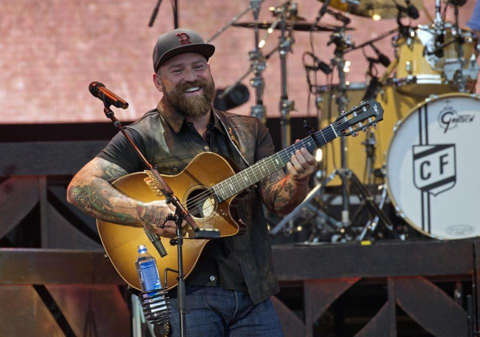 Zac Brown onstage with his band Saturday night at Fenway Park.