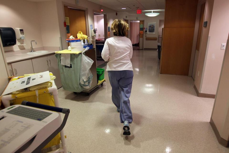 Boston, MA 12/07/2010-A nurse runs during her shift at the Clinic Center at Beth Israel Deaconess Hospital West Campus. The Supreme Judicial Court ruled Monday in favor of a ballot petition about nurse staffing levels in Massachusetts that is backed by the Massachusetts Nurses Association (Bill Greene/Globe Staff) Library Tag 02132011 National/Foreign