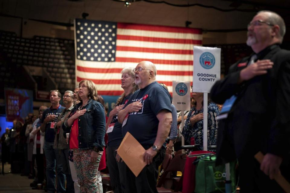 "People stand for the ""Pledge of Allegiance"" during the second day of the Republican state convention in Duluth, Minn., on Saturday, June 2, 2018. Democrats kicked off their statewide endorsing convention Friday in Rochester as Republicans gathered in Duluth. Both parties are considering candidates running for U.S. Senate, Attorney General and other statewide offices, but the main focus is on the race to replace outgoing Democratic Gov. Mark Dayton. (Glen Stubbe/Star Tribune via AP) /Star Tribune via AP)"