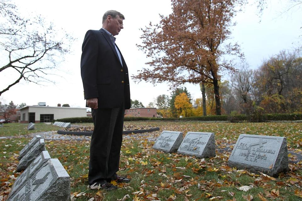 (Teweksbury, MA., 11/16/2016, Jim Graham visits the grave of Rev. Thomas S. Sulllivan. (Suzanne Kreiter/Globe staff)