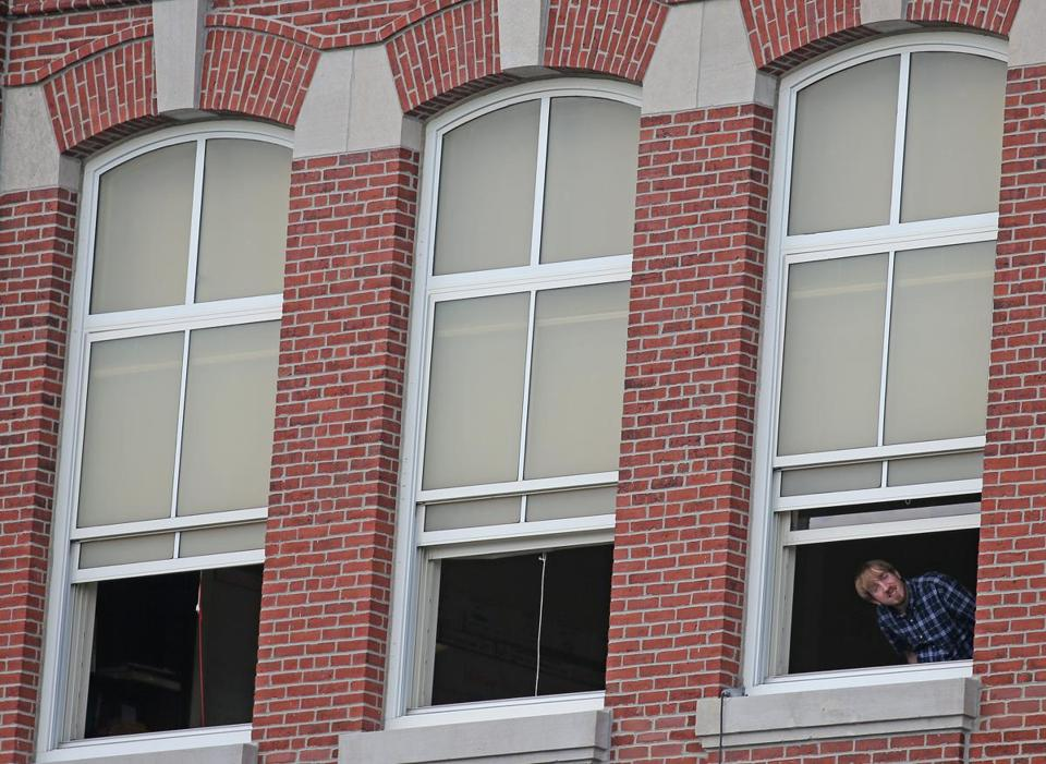 A staff member got some fresh air from a window at the Oliver hazard Perry Elementary School in South Boston.