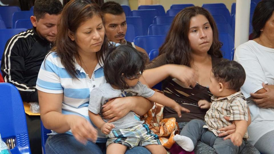 In this file photo taken on June 15, 2018 Mothers and children waited to be assisted by volunteers in a humanitarian center in the border town of McAllen, Texas.