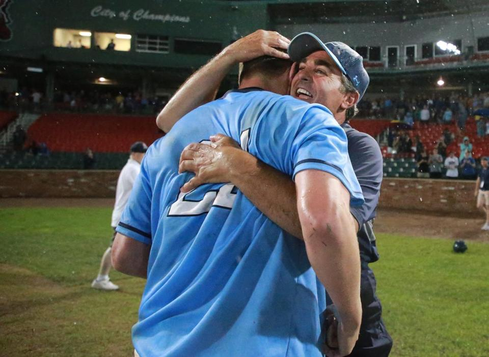 Brockton MA 6/18/18 Franklin High winning pitcher Jack Noviello hugs head coach Zack Brown after they defeated Central Catholic High 3-2 winning the MIAA Division 1A Super 8 Baseball Championship at Campanelli Stadium (photo by Matthew J. Lee/Globe staff) topic: 19schglax reporter: