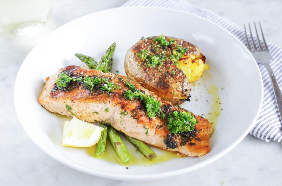 Grilled salmon with herb oil and smashed whole potatoes