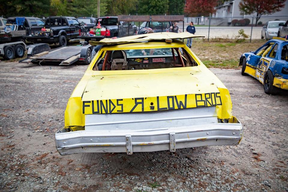 The message on the back of a car sums up the DIY attitude of some drivers at Hudson Speedway.