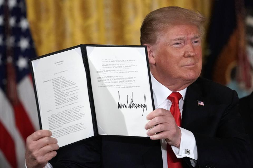 President Donald Trump held up an executive order he signed Monday ordering the creation of the Space Force.