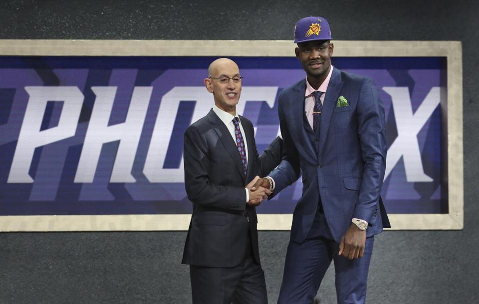 Commissioner Adam Silver with Deandre Ayton.