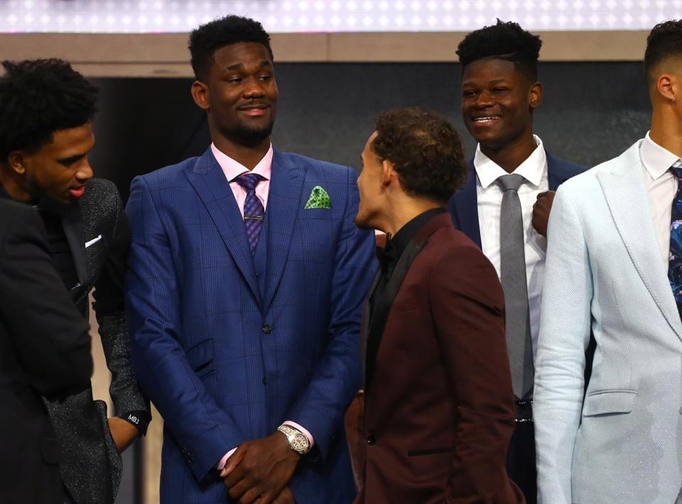 Deandre Ayton, Trae Young, and Mohamed Bamba look on before the draft.