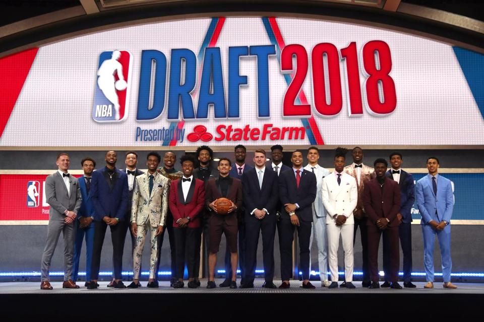 From left, Donte DiVincenzo, Jerome Robinson, Mikal Bridges, Kevin Knox, Shai Gilgeous-Alexander, Wendell Carter Jr., Collin Sexton, Marvin Bagley III, Trae Young, Deandre Ayton, Luka Doncic, Miles Bridges, Michael Porter Jr., Lonnie Walker IV, Jaren Jackson, Aaron Holiday, Chandler Hutchison, and Zhaire Smith pose for a photo before the start of the draft.