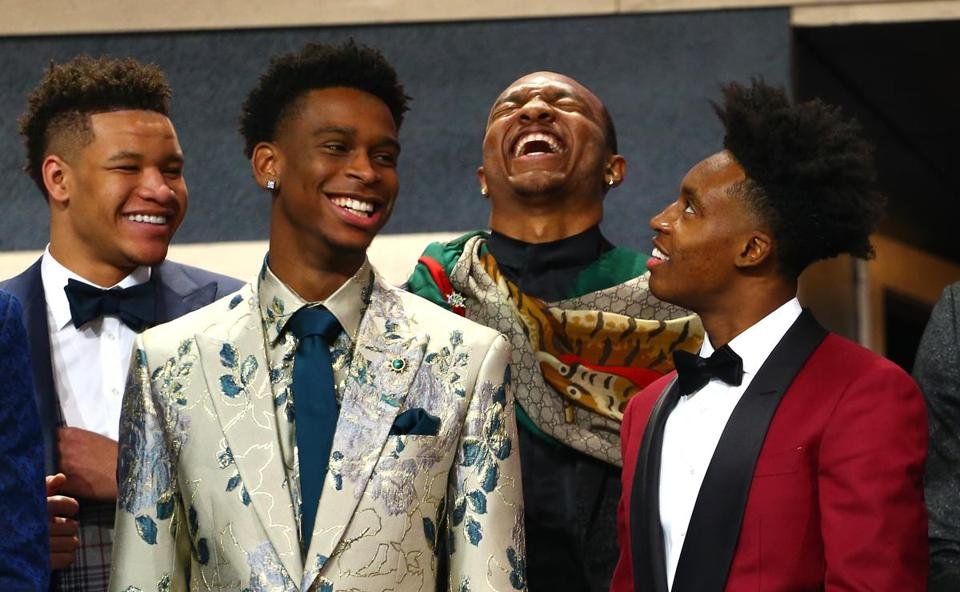 From left, Kevin Knox, Shai Gilgeous-Alexander, Wendell Carter Jr., and Collin Sexton share a laugh on stage before the start of the draft.