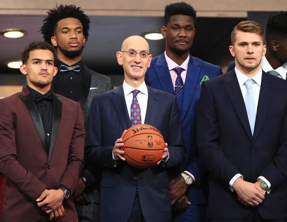 Commissioner Adam Silver (center) poses with prospects Trae Young, Marvin Bagley III, Deandre Ayton, and Luka Doncic.