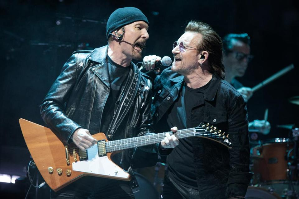 From left: The Edge, Bono, and Larry Mullen Jr. performing during U2's concert Thursday at TD Garden.
