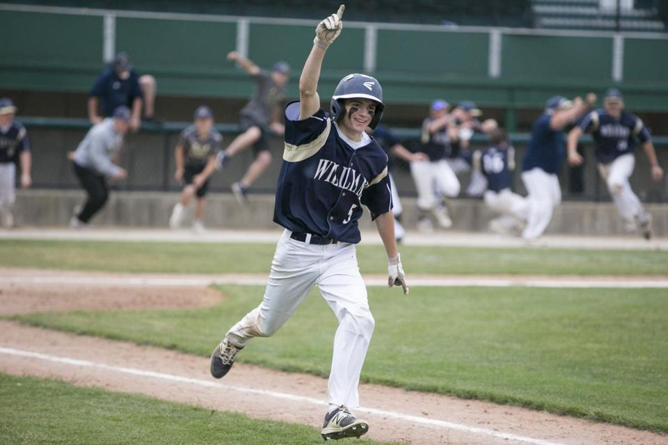 Archbishop Williams sophomore batter David Ryan celebrates his game winning RBI single in the ninth inning of the MIAA Division 4 baseball championship against Oxford High at Hanover Insurance Park at Fitton Field at Holy Cross in Worcester, Massachusetts on June 23, 2018. Archbishop Williams defeated Oxford 4-3 in nine innings. Matthew Healey for The Boston Globe (SPORTS)