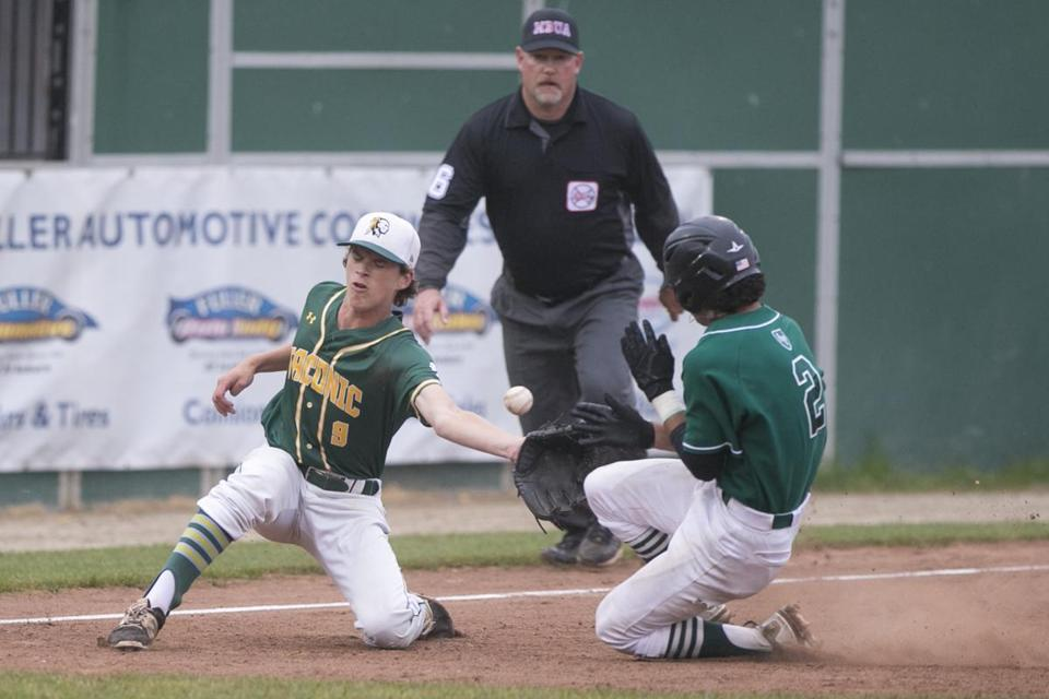 Austin Prep's Dylan Arnold slides into third as the throw gets away from Taconic third baseman Colby Sherman.