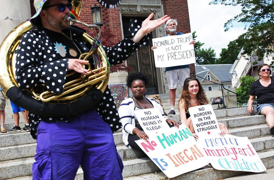 "Rally participants listened to speeches and sang along to songs such as ""This Little Light of Mine"" during the Jamaica Plain rally."