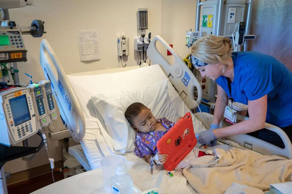 Rocket Cueto, 5, received medication from a nurse at the new Lucile Packard Children's Hospital.