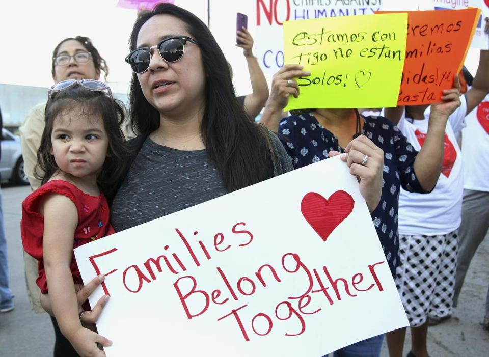 Letty Leal, with her daughter Alyssa, 2, of McAllen, Texas, joins a protest at the Border Patrol processing center in McAllen on Monday, June 25, 2018. (Delcia Lopez/The Monitor via AP)