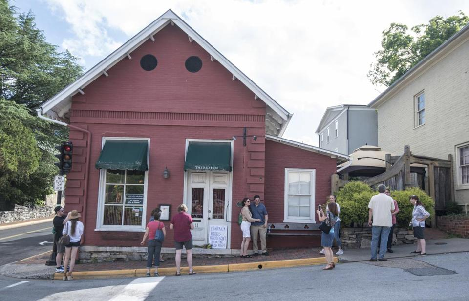 Passersby gathered to take photos in front of the Red Hen Restaurant on Saturday.