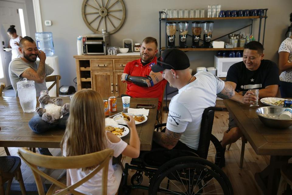 Rome, ME--6/26/2018-- Travis Mills (C) shares lunch with wounded veterans and their families at the Travis Mills Retreat. (Jessica Rinaldi/Globe Staff) Topic: 01maine Reporter: Brian MacQuarrie