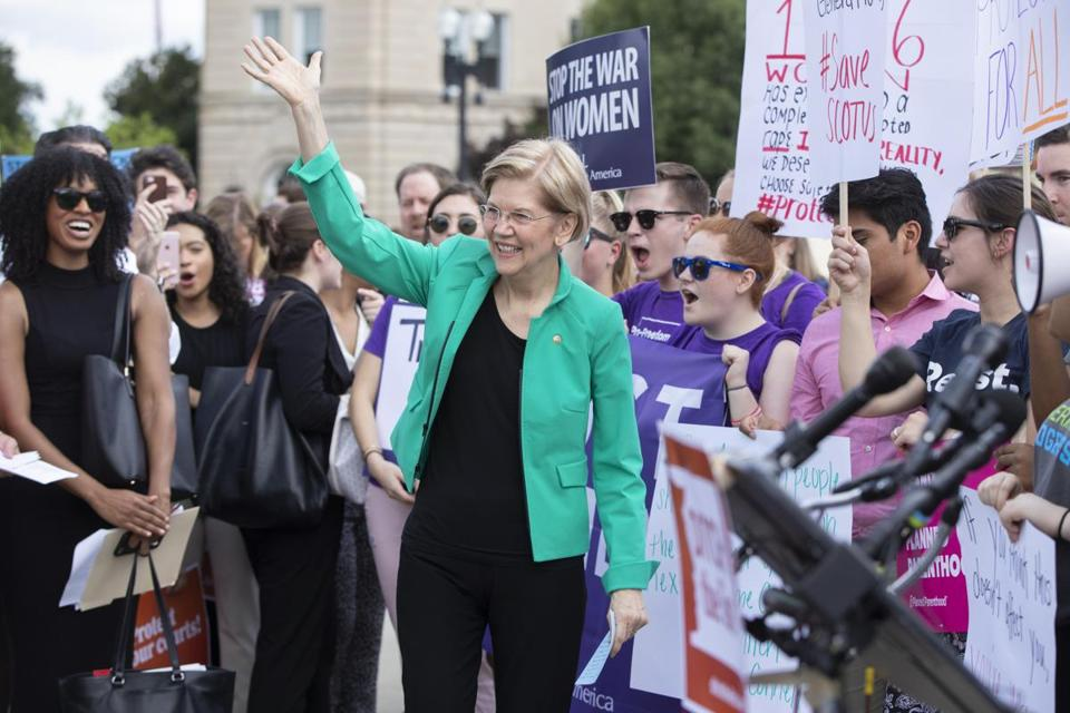 "Senator Elizabeth Warren told activists at the Supreme Court Thursday she would fight the president's nominee ""with every bone in my body."""