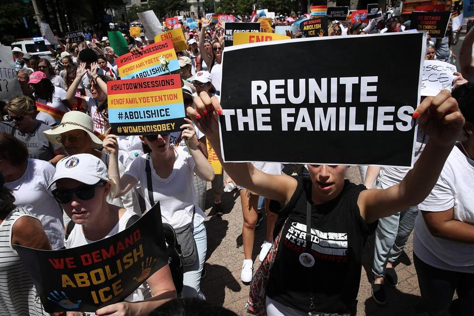 WASHINGTON, DC - JUNE 28: Protesters march from Freedom Plaza to demonstrate against family detentions and to demand the end of criminalizing efforts of asylum seekers and immigrants June 28, 2018 in Washington, DC. More than 1,000 women from 47 states took part in the march that will end later today at the U.S. Capitol. (Photo by Win McNamee/Getty Images)