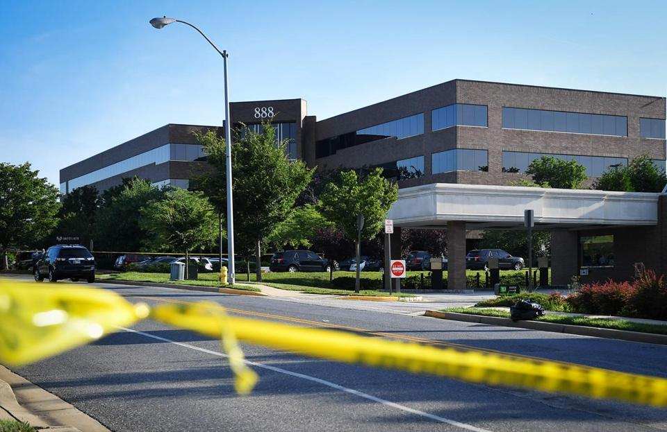 Police tape blocked access from a street leading to the building complex where The Capital Gazette is located in Annapolis, Md.