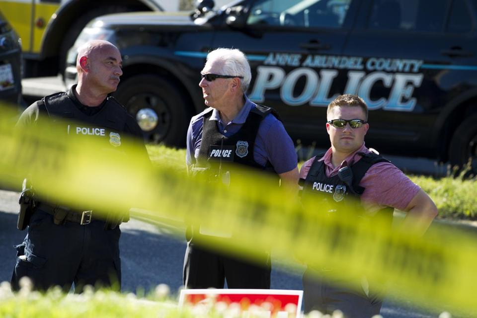 Police officers secured the area after multiple people were shot at an office building housing The Capital Gazette newspaper in Annapolis, Md., Thursday.