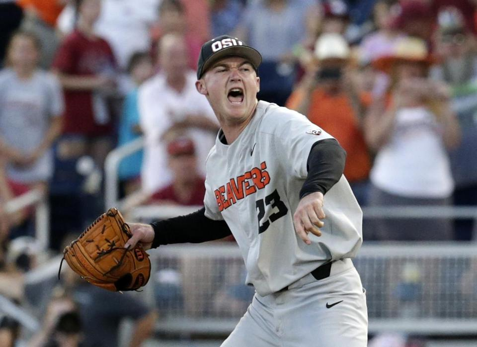 Oregon State pitcher Kevin Abel reacts after he threw a complete game shut out and his team beat Arkansas 5-0 in Game 3 to win the NCAA College World Series baseball finals, Thursday, June 28, 2018, in Omaha, Neb. (AP Photo/Nati Harnik)