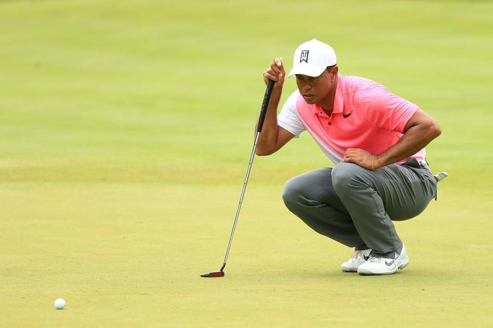 tiger woods settles for a 70 using new putter