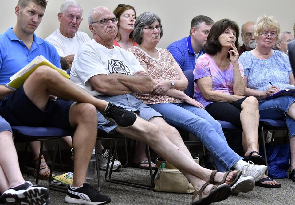 MILLVILLE, 7/4/2018 - Town residents look on during a special Board of Selectmen outlining cuts to town services. Voters rejected a Prop 2 1/2 override vote forcing the town to end trash service, closed its senior center, and to turn off more than half of it's street lights. Josh Reynolds for The Boston Globe (Metro, Crimaldi)