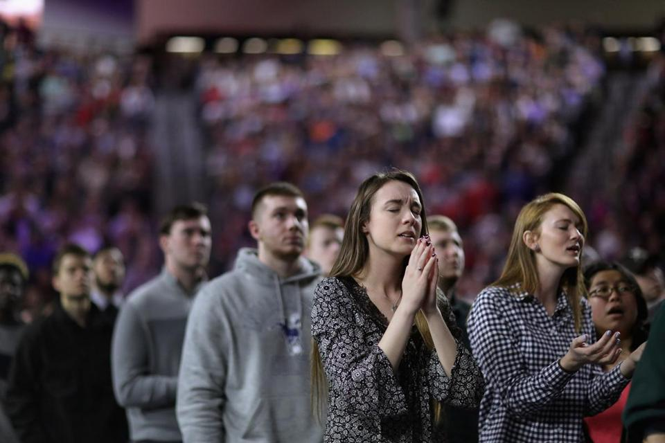 LYNCHBURG, VA - JANUARY 18: Thousands of students, supporters and invited guests sing songs of Christian praise before Republican presidential candidate Donald Trump delivers the convocation in the Vines Center on the campus of Liberty University January 18, 2016 in Lynchburg, Virginia. A billionaire real estate mogul and reality television personality, Trump addressed students and guests at the non-profit, private Christian university that was founded in 1971 by evangelical Southern Baptist televangelist Jerry Falwell. (Photo by Chip Somodevilla/Getty Images)