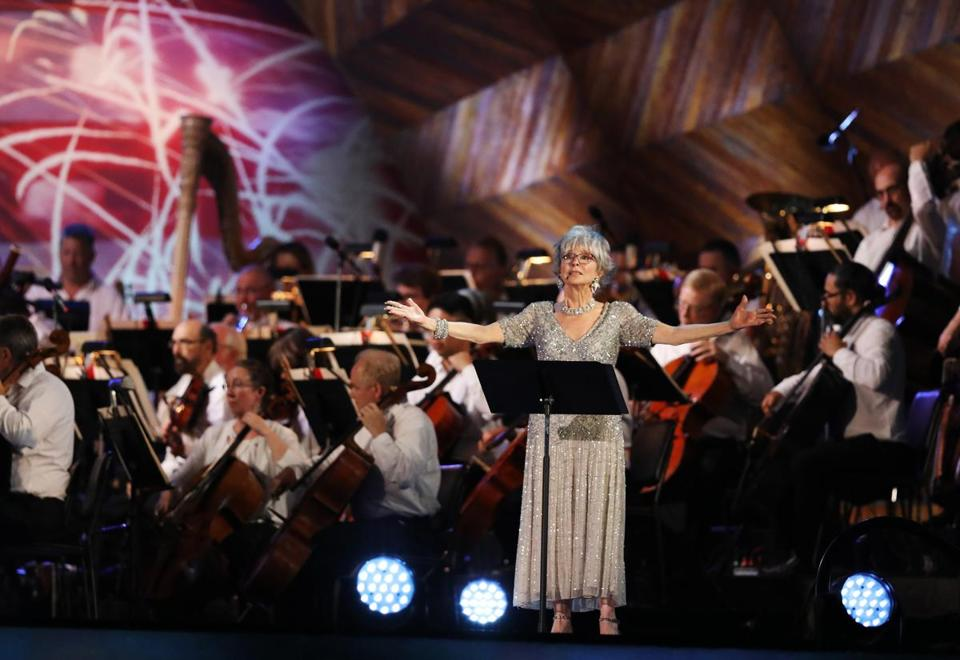 "BOSTON, MA - 07/04/2018 Rita Moreno performs with the Boston Pops Orchestra during the Boston Pops Fireworks Spectacular. Despite the heat; ""a large crowd came out to celebrate one of the country's largest and oldest public Fourth-of-July events that took place on the Esplanade. Erin Clark for the Boston Globe"