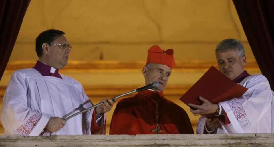 Cardinal Jean-Louis Tauran (center) announced the newly elected Pope Francis at St. Peter's Basilica in 2013.