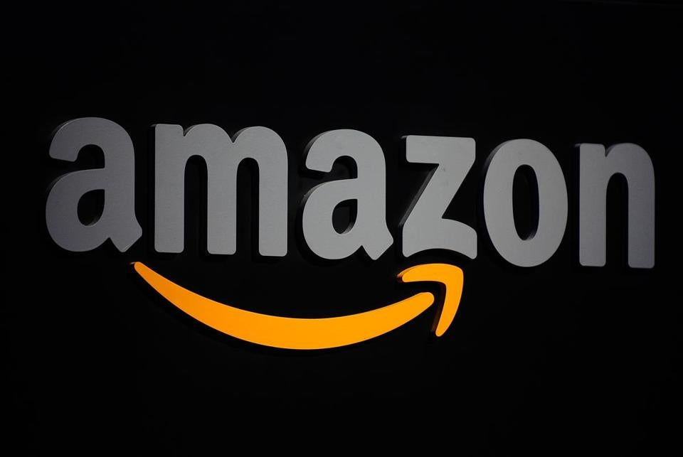 (FILES) In this file photo taken on September 28, 2011, the Amazon logo is seen on a podium during a press conference in New York. Shares of pharmacy retailers were hammered early on June 28, 2018, as Amazon entered the market and as Wall Street stocks retreated amid worries over trade tensions. Amazon announced it was acquiring online pharmacy PillPack for terms that were undisclosed, its biggest move yet into healthcare. Amazon shares rose 0.2 percent. But the move by Amazon pummeled pharmacy chains, with CVS Health diving 6.9 percent and Rite Aid plunging 12.6 percent. / AFP PHOTO / Emmanuel DUNANDEMMANUEL DUNAND/AFP/Getty Images