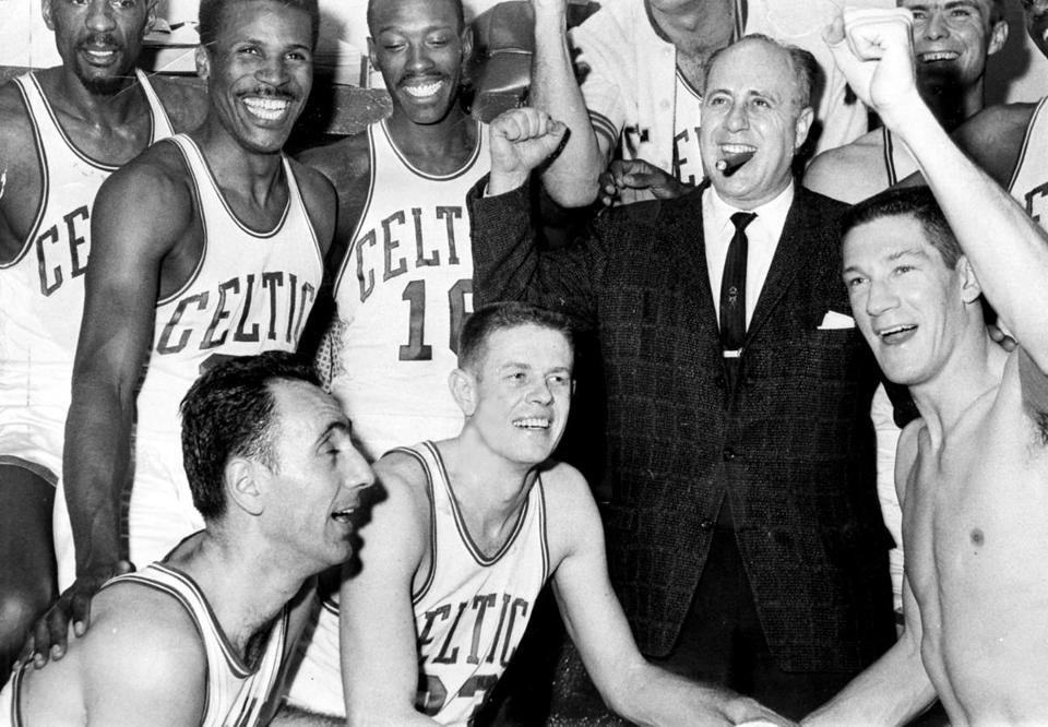 "Sports Print scan/ A.P. photo 4/10/1963 *** ""Red Auerbach"" Boston Celtics President and General Manager . Coach Auerbach with jubilant Celtics players after winning Estern division title in seventh game against Cincinnati Royals 142-131. Bob Cousey and Frank Ramsey are in left foreground with John Havlicek at right. In rear l-r casey Jones, Sam Sanders and Tom Heinsohn (cq)"