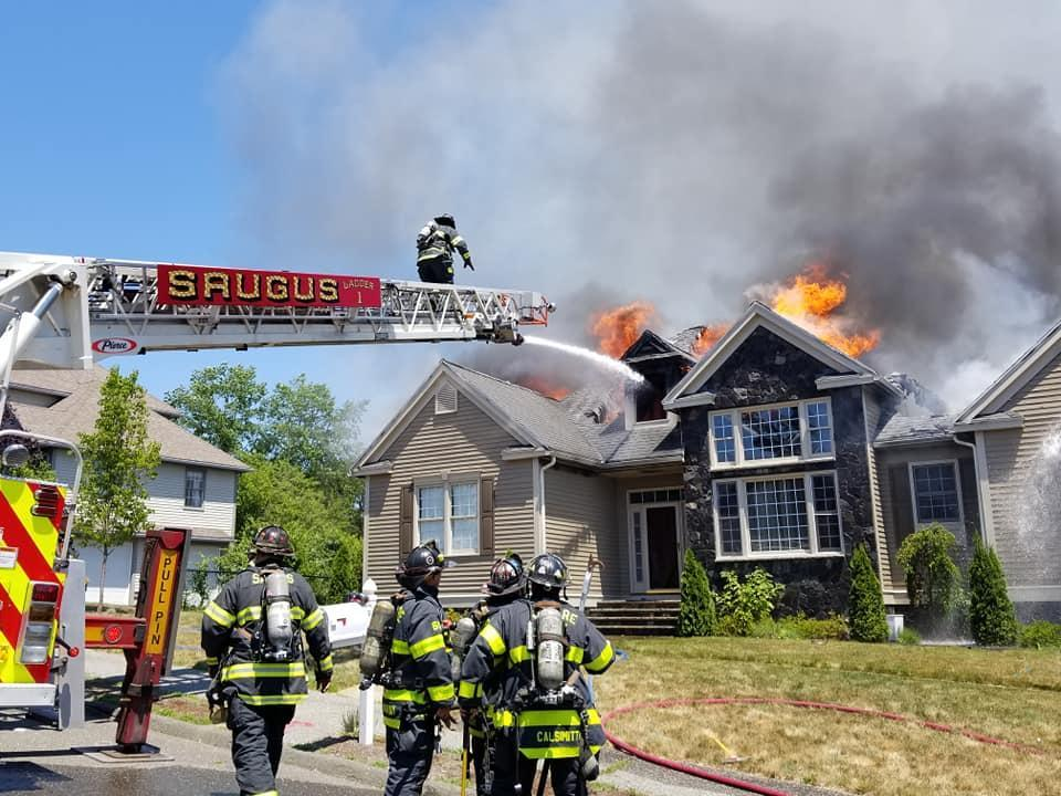 Firefighters from at least seven fire departments worked to put out a three-alarm fire in Saugus Tuesday afternoon.