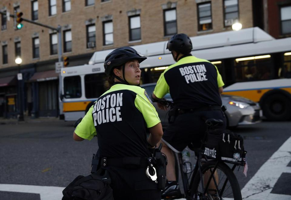 Boston, Massachusetts -- 9/18/2015-- Boston Police Department's bike unit officer Shandra Pinto looks over her shoulder as she and a fellow officer wait for a light to change while on patrol in Boston, Massachusetts September 18, 2015. Jessica Rinaldi/Globe Staff Topic: 21bikeunit Reporter: