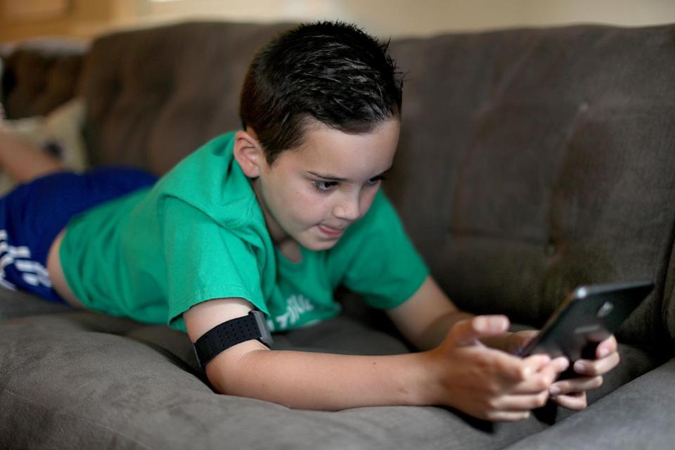 Tate plays the Mightier video game for about an hour a week. During gameplay, he wears an armband to track heart rate.