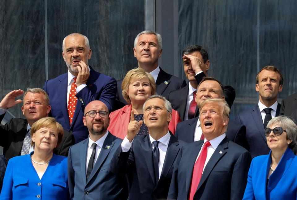 (First row LtoR) German Chancellor Angela Merkel, Belgium's Prime Minister Charles Michel, NATO Secretary General Jens Stoltenberg, US President Donald Trump, Britain's Prime Minister Theresa May (second row LtoR) Denmark's Prime Minister Lars Lokke Rasmussen, Norway's Prime Minister Erna Solberg, Poland's President Andrzej Duda, French President Emmanuel Macron (third row) Albania's Prime Minister Edi Rama, Czech Republic President Milos Zeman and Spain's Prime Minister Pedro Sanchez watch a helicopter fly-past while they pose for a family picture ahead of the opening ceremony of the NATO (North Atlantic Treaty Organization) summit, at the NATO headquarters in Brussels, on July 11, 2018. / AFP PHOTO / POOL AND AFP PHOTO / LUDOVIC MARINLUDOVIC MARIN/AFP/Getty Images
