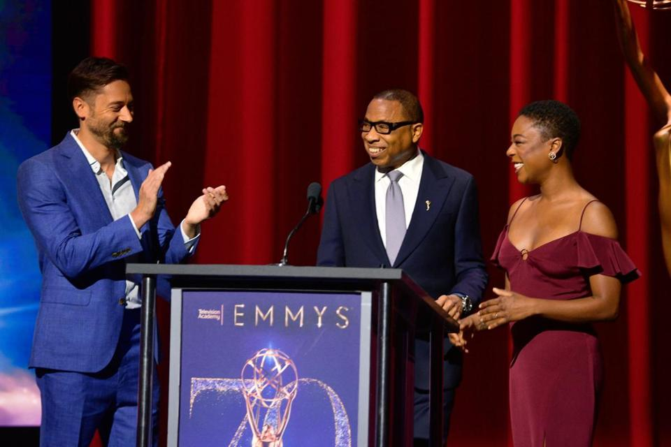 From lef: Ryan Eggold, Television Academy Chairman and CEO Hayma Washington, and Samira Wiley speak onstage during the 70th Emmy Awards Nominations Announcement.