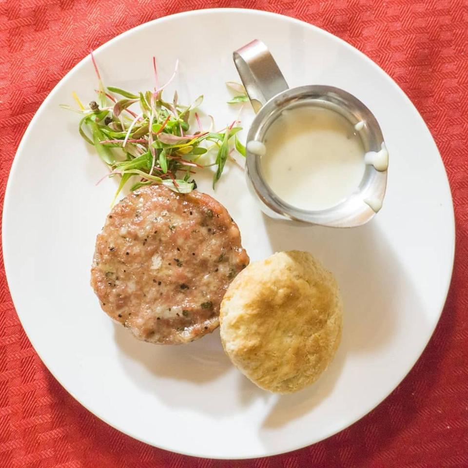Fresh made breakfast sausage, country gravy, and grist mill buttermilk biscuit with a micro salad from Mass Cannabis Chefs.