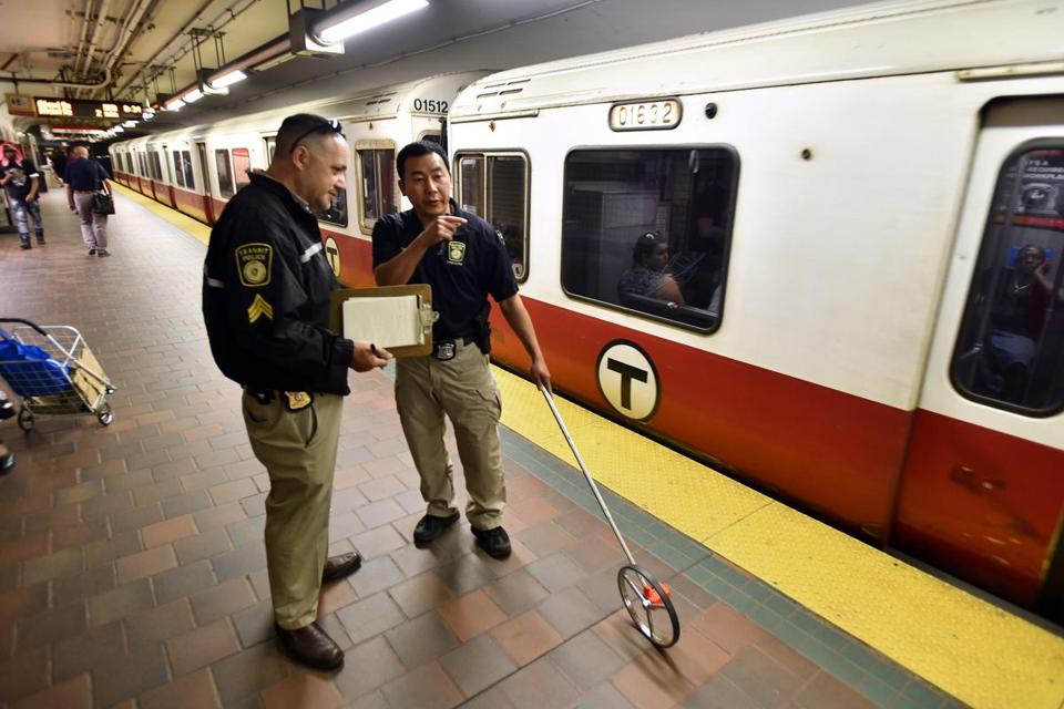 Investigators measured off a location on the platform after Redline subway service was shut down after a person became caught between the train and the platform at Central Square.