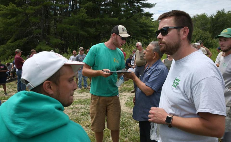 Ben Grant (center) during the auction of his family's farm in Saco, Maine.